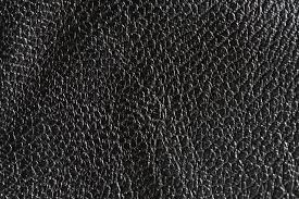 black rough leather textured background