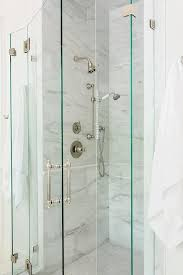 glass shower doors frame a stand up