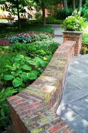 brick garden wall with bluestone paving