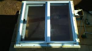 equip earthbag walls with windows