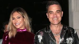 Robbie Williams and Ayda Field welcome surrogate baby - BBC News