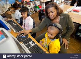 Detroit, Michigan - First grade teacher Ivy Bailey teaches computers Stock  Photo - Alamy