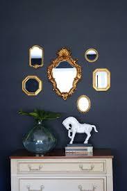 navy walls small gold mirrors