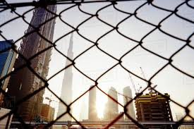 Skyscrapers Chain Link Fence On Background Stock Photo Dissolve