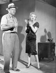 Marilyn Monroe with director Joshua Logan on the set of Bus Stop ...