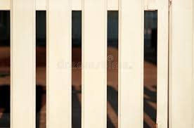 part of white wooden decorative fence