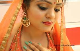 party makeup with orange dress indian
