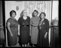 Group portrait, from left: Ovetta Johnson, Edith Smith, Mattie Hightower,  and Isabelle Hunter posed in interior with floral curtains | CMOA Collection