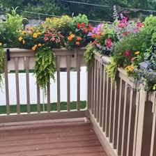 Beige Deck Rail Planters With Hooks On Corner Of Railing Deck Railing Planters Deck Planters Deck Railings