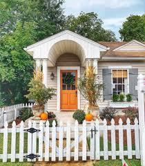 17 Fall Decor Ideas The Hank Miller Team White Exterior Houses Fall Decor Fall Door Decorations