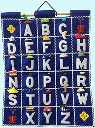 Amazon Com Pockets Of Learning Abc Wall Hanging Blue Alphabet Fabric Wall Decor For Children Kid S Room Decor Toys Games