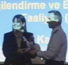 AKP'li paşa, Erenerol'a plaket vermiş