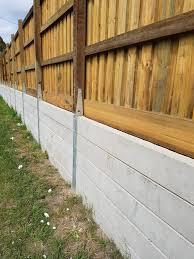 Pioneer Range Concrete Sleeper Retaining Wall Using The Fence Bracket Sy Concrete Retaining Walls Backyard Landscaping Designs Concrete Sleeper Retaining Walls