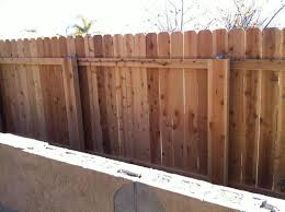 Building A Wooden Fence Over Metal Poles Easy Fence Modern Fence Backyard Fences