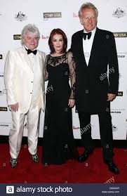 Russell Hitchcock, Priscilla Presley and Graham Russell of the band Stock  Photo - Alamy