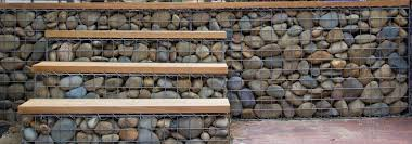 Gabion Fences And Stone Walls With Images Fence Design Gabion Fence Rock Fence
