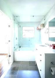 dark bathroom floor tiles vanity light