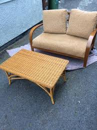 two seater and wicker coffee table