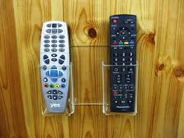 two tv remote controls wall holder