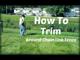 How To String Trim Weed Eat Weed Whack Around Chain Link Fence Youtube