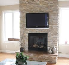 split stone fireplace with tv modern