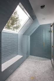 walk in shower with blue glass tiles