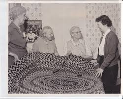 Photograph of Susie Penniman, Addie Rogers, Carrie Westgate and Margaret  Rosa making a rug 1956 · Plainfield Historical Society