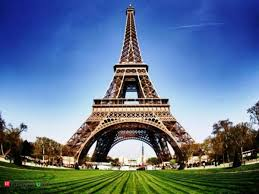 eiffel tower lit green in honor of