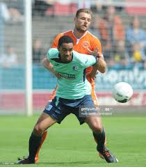 Barrows Byron Harrison under pressure from Blackpool's Ryan Edwards... News  Photo - Getty Images