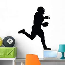Amazon Com Wallmonkeys Wm123137 Football Silhouette Wall Decal Peel And Stick Graphic 36 In H X 27 In W Home Kitchen