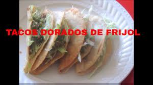 tacos dorados de frijol con salsa de