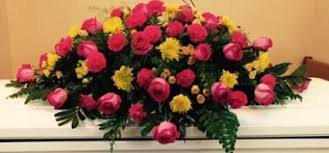 pink and yellow mixed casket spray