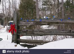 Christmas Decorations On An Old Wooden Fence Outside In The Snow Stock Photo Alamy