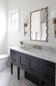 sconces flank a gold leaf vanity mirror