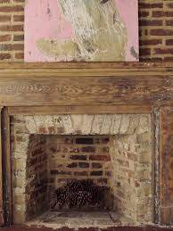 a rustic fireplace like really rustic