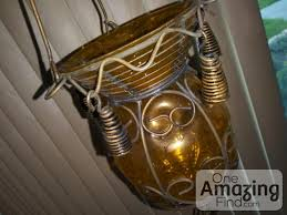 metal and golden yellow glass hanging