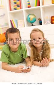 Kids Sharing Earphones Music Player Laying Stock Photo Edit Now 81144541