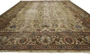 distressed vintage persian tabriz rug