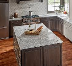 granite countertops and tile backsplashes