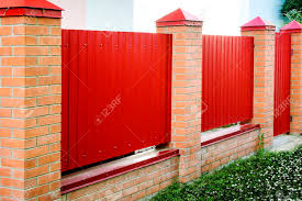 Brick And Metal Red Fence With Door And Gate Of Modern Style Stock Photo Picture And Royalty Free Image Image 89962981