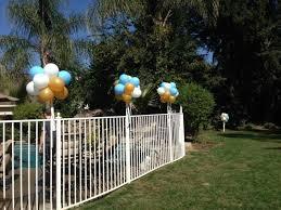 Along A Fence Balloon Decorations Outdoor Party Outdoor Decor