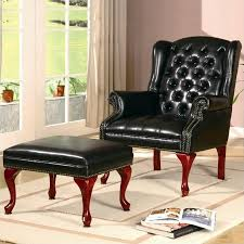 wing back tufted faux leather arm chair