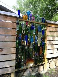Privacy Fence With Great Bottle Shapes Maybe Morph Into Freestanding Art For Cactus Garden Or Use As Fun Trellis For R In 2020 Fence Decor Fence Art Wine Bottle Fence