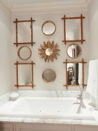 large bathtub and bamboo framed mirrors