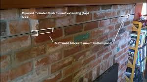 tiling over brick fireplace mantle