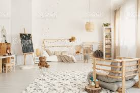 Kids Room Interior With A Teddy Bear On The Floor Blackboard Bed Shelves And Wooden Armchair Stock Photo Download Image Now Istock