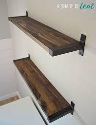 dark wood shelf with black iron hanger