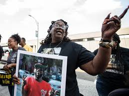 Marcus Smith supporters mark the anniversary of his death with vigil;  family 'still lost, still confused with unanswered questions' | Local News  | greensboro.com