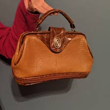 70s taupe caramel leather bag brand