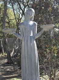 famous bird girl statue from midnight